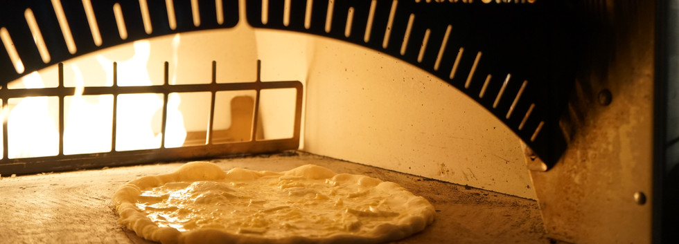 Pizza in Wood Stone Oven