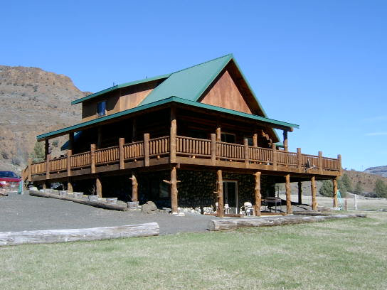 99282 - Custom Hand Peeled Log Home on River