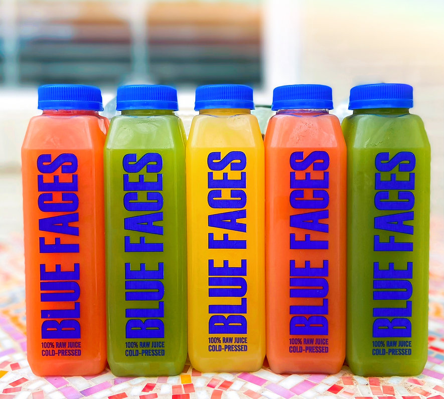 blue face juice bottles.jpeg