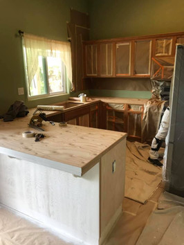 Before Pic of White Kitchen Cabinets