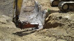 Removing concrete head wall