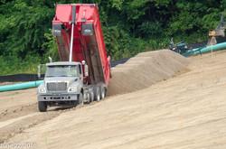 Trucks dumping sand