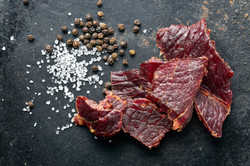 beef jerky and spice on old table.jpg