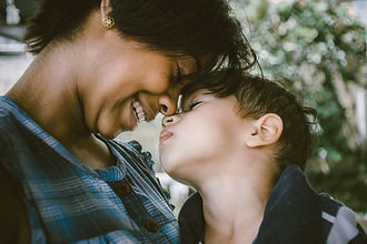 Mom and son head to head, face to face, feeling connected after counseling for moms of teens st. louis, mo. You can feel better after counseling for moms st. louis, mo and online therapy for women in missouri at Marble Wellness!