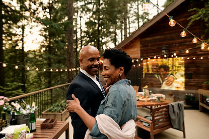 Happy black couple dancing outside. They have found their groove with couples and marriage therapy. Talking out their feelings in couples therapy has helped them find harmoney. If you're looking for some stability, marriage counseling.