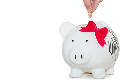 Piggy bank with bow. Therapy for overwhelmed mom in Missouri with online therapy for women in Missouri and anxiety treatment is here. Get your question about insurance and therapy fees here.