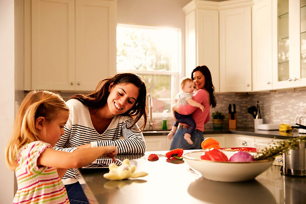 Family in the kitchen with moms and babies feeling connected. Counseling for moms and maternal overwhelm in St. Louis, MO can help. Marble Wellness provides in person and online therapy in Missouri for maternal mental health counseling st. louis, mo