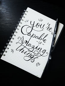 notebook with writing you are capable of amazing things. There is hope after depression treatment in St. Louis, MO and after counseling for depression in St. Louis, MO at Marble Wellness 63122