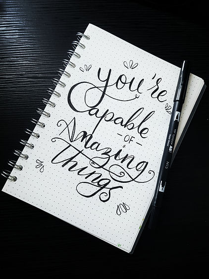 notebook with writing you are capable of amazing things. There is hope after depression treatment in St. Louis, MO and after counseling for depression in St. Louis, MO at Marble Wellness 63011