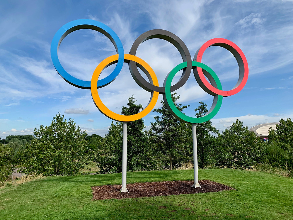 """Olympic rings. The Tokyo Olympics and Simone Biles can teach us all about prioritizing mental health, even when it seems like we """"shouldn't."""" For help implementing tips like this in your life, reach out to Marble Wellness for grief counseling, depression therapy, or counseling for anxiety."""