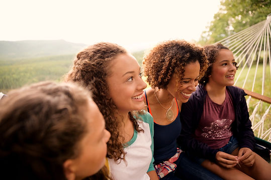 Happy family of girls on a hammock, with counseling for moms of teens. You can get help because parenting teenagers is hard! Get counseling for moms of teens st. louis, mo with STL therapist Stephanie. Get the help you need with online therapy in Missouri and online counseling in Saint Louis, MO