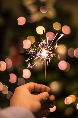 Sparkler being held for grief counseling in st. louis to help you heal from the grieving process with online therapy in missouri, park therapy in Kirkwood, MO and counseling for women in missouri.
