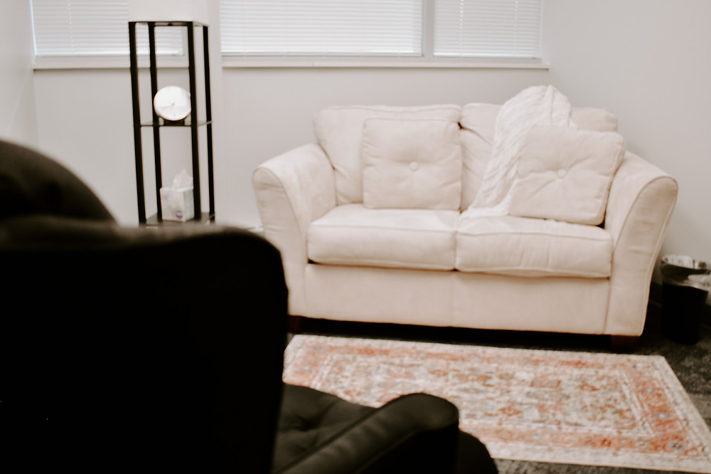 Client couch in a therapy office at Marble Wellness, a St. Louis, MO counseling practice. We serve moms, couples, kids, and teens. We can help with anxiety, depression, grief, chronic illness, and maternal overwhelm. Reach out today!
