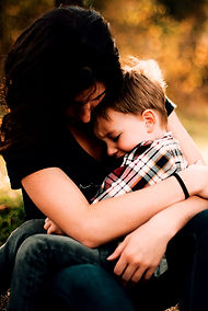 A mom hugging her young son feeling anxious and overwhelmed. Our therapists offer counseling for Moms in the St. Louis, MO