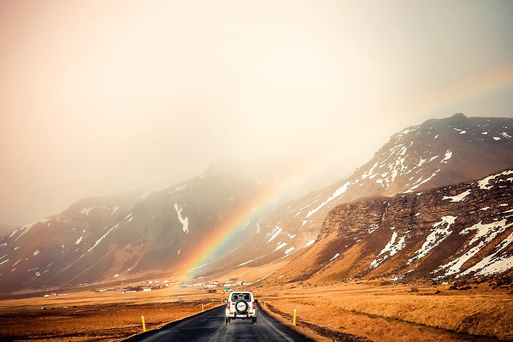Car driving into the mountains with a rainbow. There is hope after depression treatment in St. Louis, MO and after counseling for depression in St. Louis, MO at Marble Wellness 63011