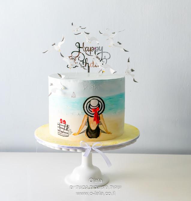 עוגה עם אישה בים
