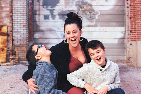 Family photo.  Mom and young sons laughing together.