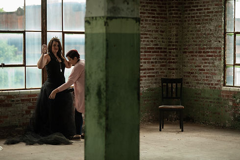 Shanna adjusting a skirt on a client at a styled shoot.