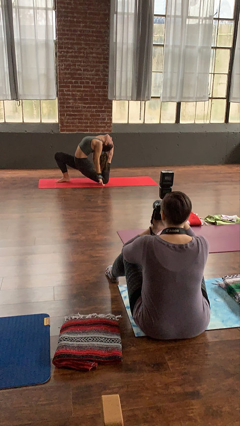 Behind the scenes of Shanna Dugan taking a photo of a client in a yoga pose.