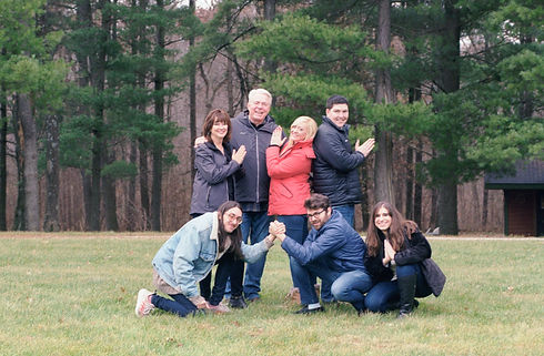 Adult family posing silly.