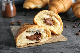 Yummy fresh croissant with chocolate on