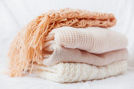 Pilha de cachecóis de lã