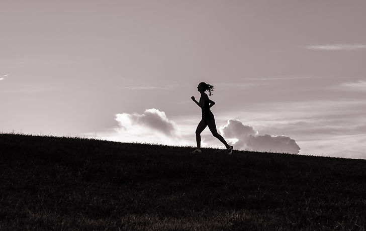 lady running on beach.jpg