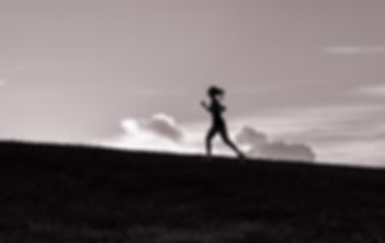 Bec silhouetted whilst running
