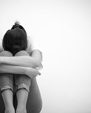 sad woman hug her knee and cry (monochro
