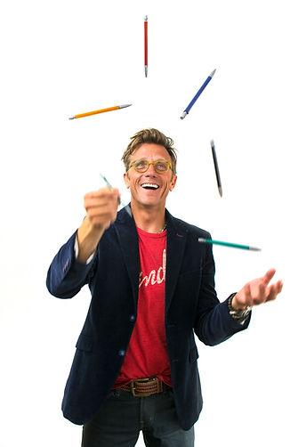 Adrian pen juggle.jpg