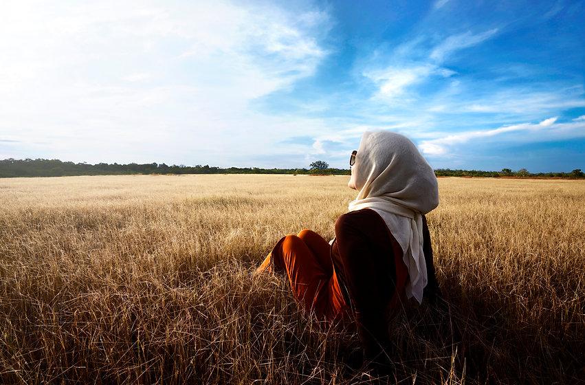 Canva - Muslim woman wearing hijab relax