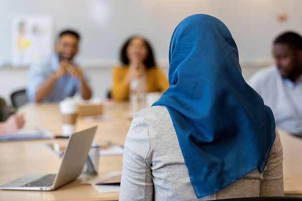Canva - Rear view of Muslim businesswoma