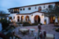 wall-mounted-lanterns-brick-patio-arched