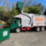 Front loader dumping a four yarder in New Jersey