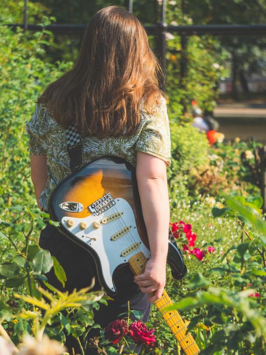 Niamh O'sullivan Guitar and flowers