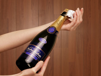 Hvordan åpne en champagneflaske?