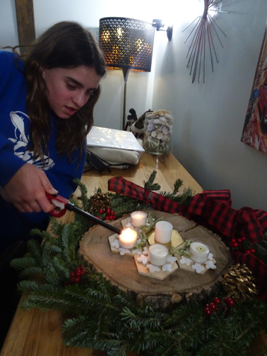Anya lighting the advent wreath.JPG