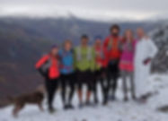 Juneau runners on mountain snow
