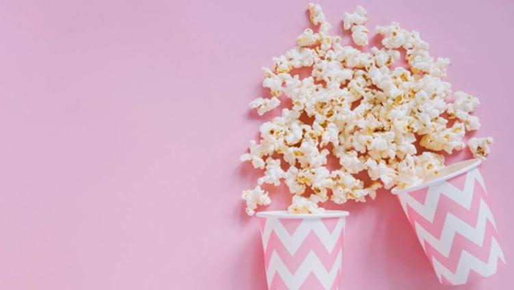 pink-popcorn-background_23-2147775775.we