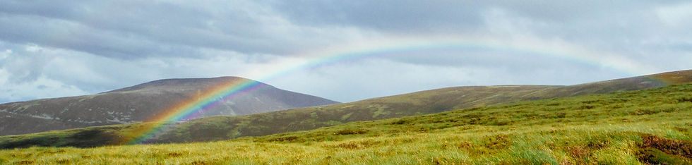 Rainbow in the hills of the highlands