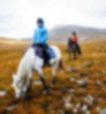 Horse riding under Suilven in Scotland
