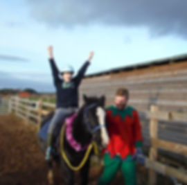 Kids learning to ride horses in Tain