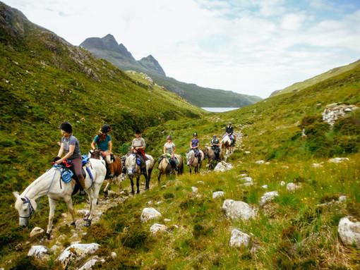 Horse riding under Suilven