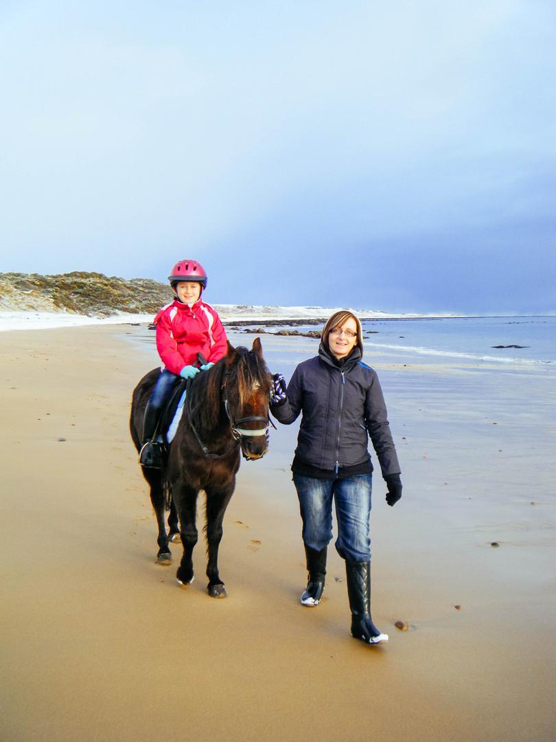 Leading kids across the beach