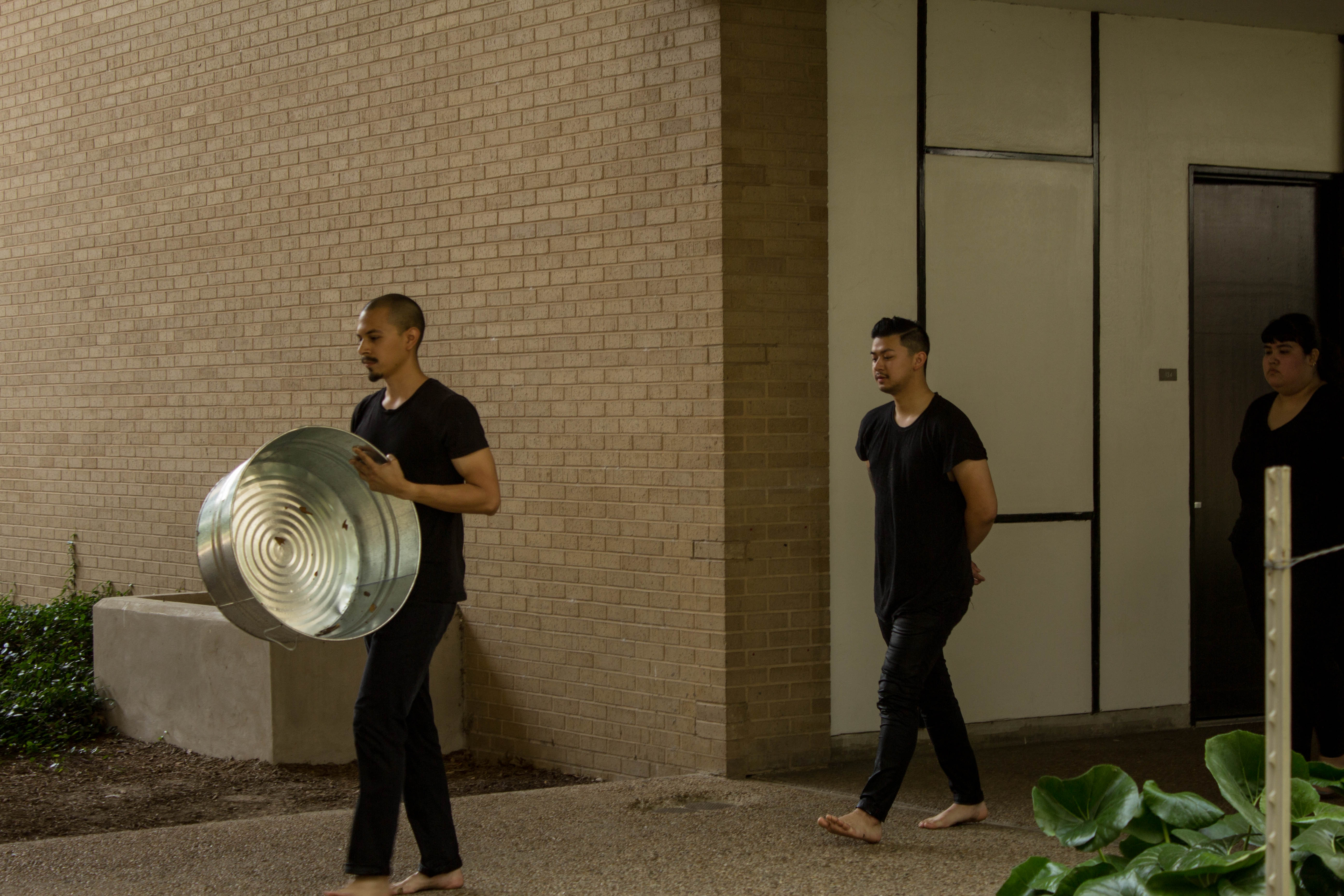 Image: Artist with bucket drumming and leading other artists