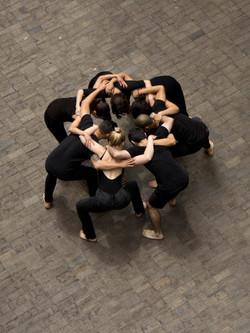 Image: Artists huddled together