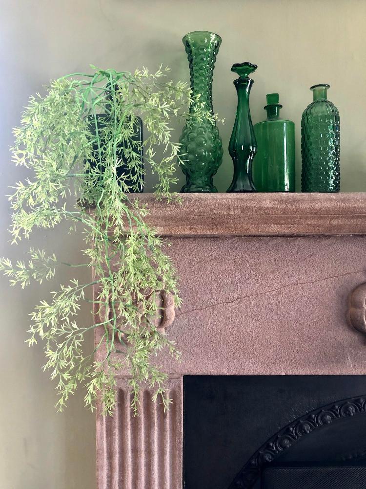 vintage green glassware green bottles jewel tones mantel decor fireplace