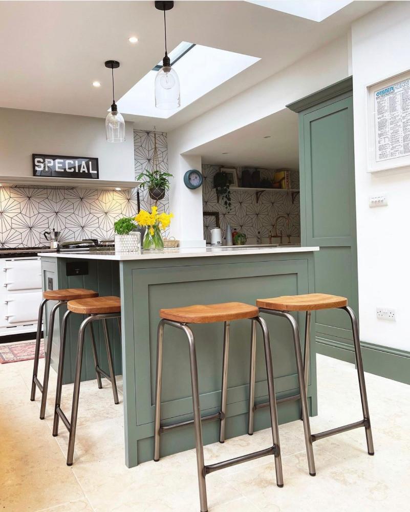 green kitchen island industrial bar stools glass pendant lights