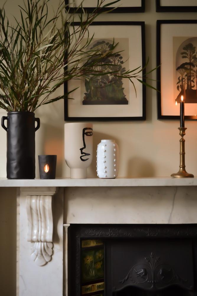 fireplace mantel styling black white vases framed prints candlesticks