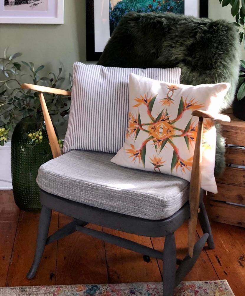 ercol mid-centuary armchair bird of paradise cushion green sheepskin